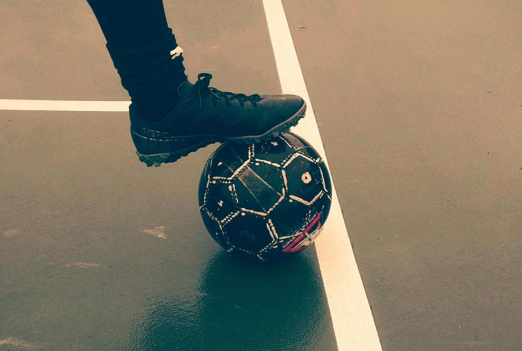 soccer player with ball futsal court