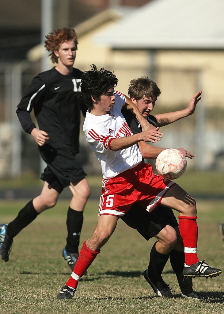 Receiving a soccer throw-in as a defender strong on the ball