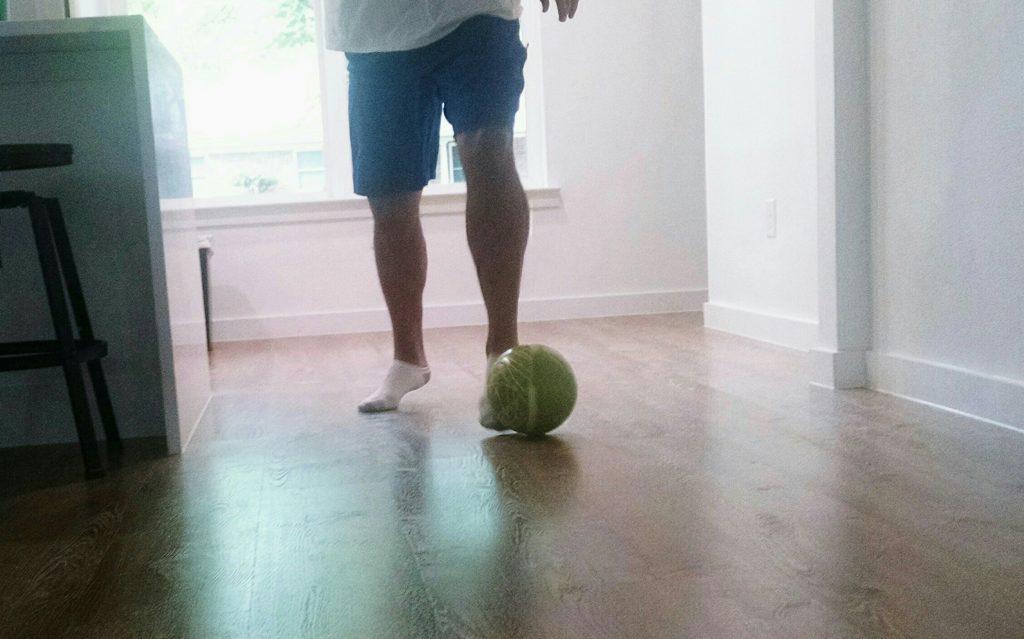 dribbling soccer ball in house