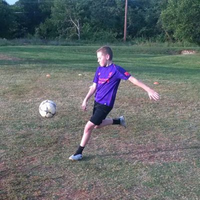 soccer player volleys on goal