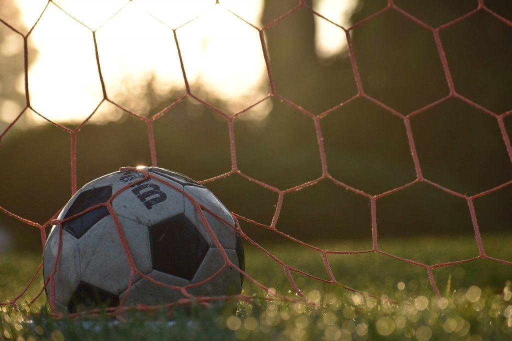 soccer tryout ball in goal net